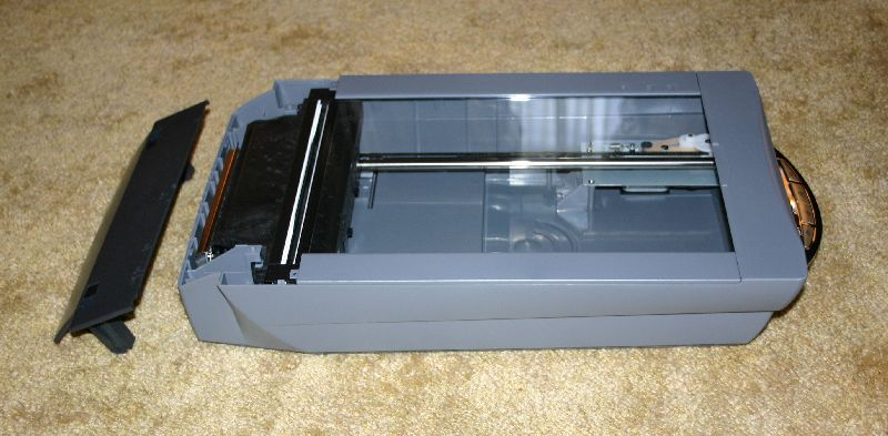 How to remove the glass from a Canon 9950 scanner for cleaning